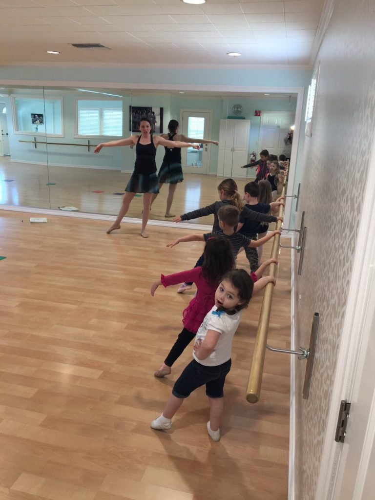Children in the middle of a dance lesson